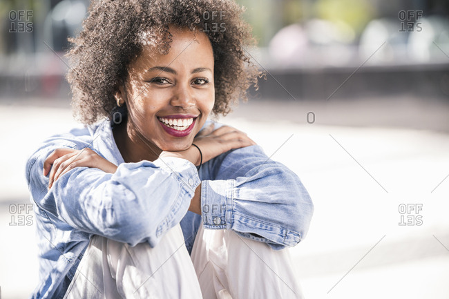 Portrait of happy young woman outdoors