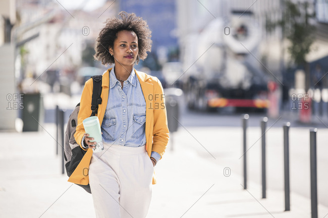 Young woman in the city on the go