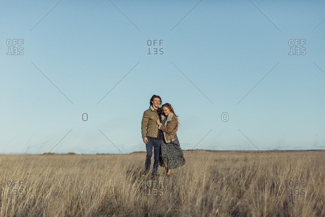 Couple with dread locks embraced in the woods, Lleida, Spain