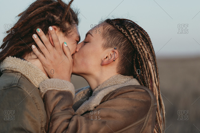 Couple with dread locks sharing a passionate kiss