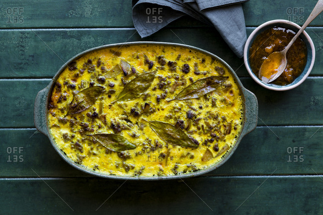Overhead view of a South African Bobotie dish with curried ground beef, baked with a rich savory custard