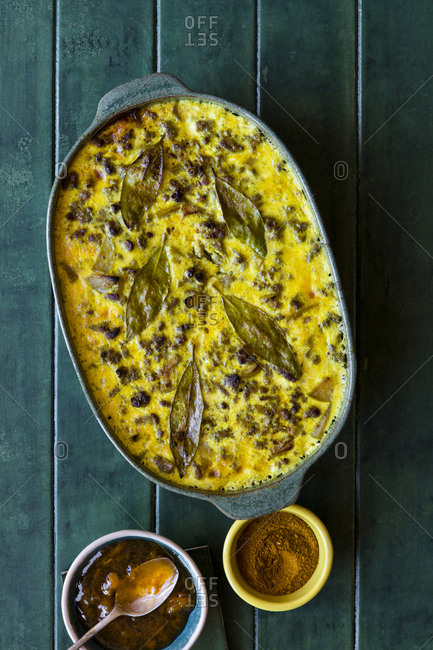 Top view of a South African Bobotie dish with curried ground beef, baked with a rich savory custard