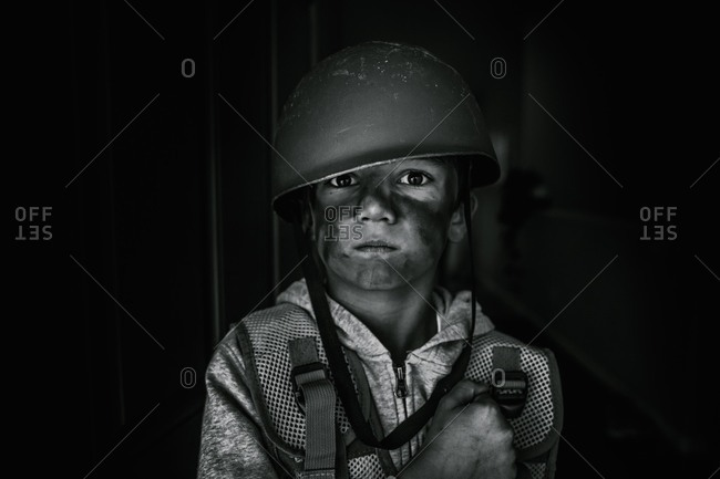 Boy dressed as a soldier in black and white