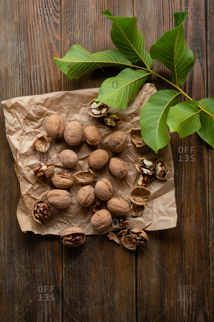 Harvest of walnuts on wooden surface