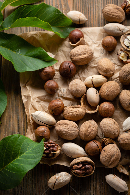 Raw nuts and green leaves
