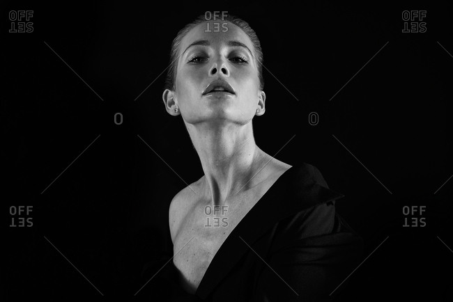 Portrait of a beautiful woman wearing low-cut top posing seductively