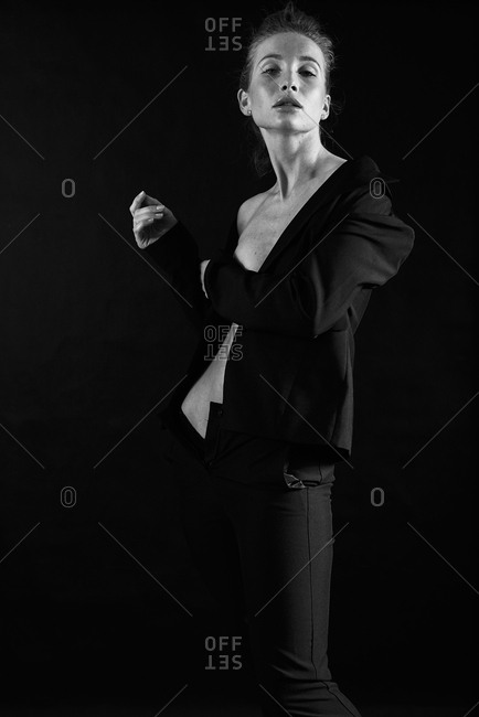 Portrait of a beautiful woman wearing undressing in black and white