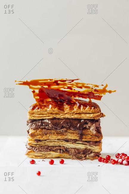 Chocolate and caramel puff dough dessert with fresh cranberry
