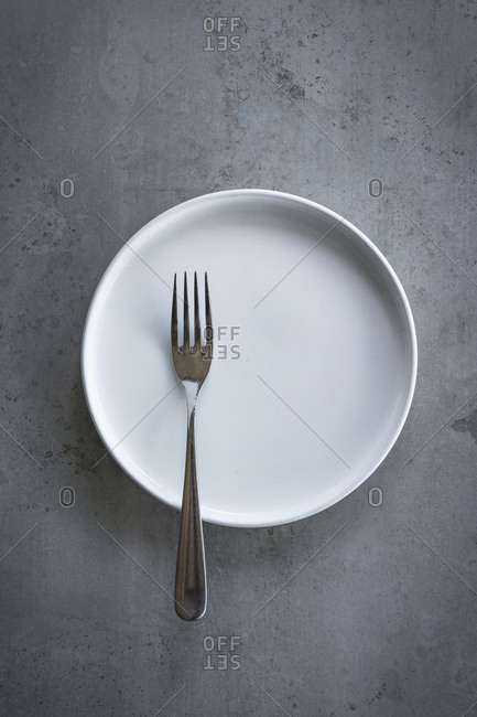 A fork on a white plate