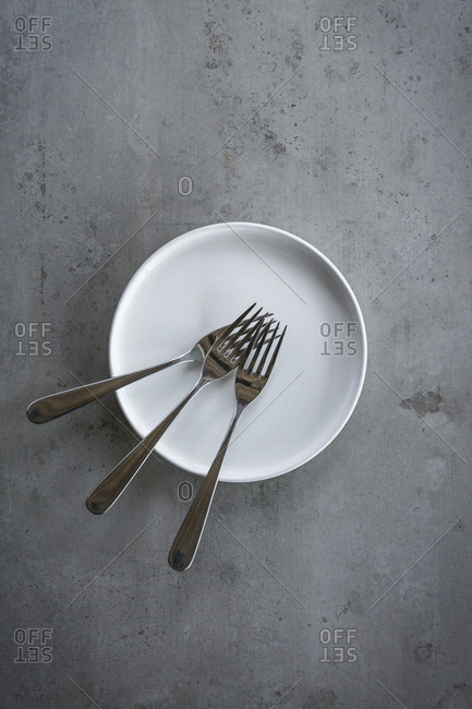 Three forks on a white plate