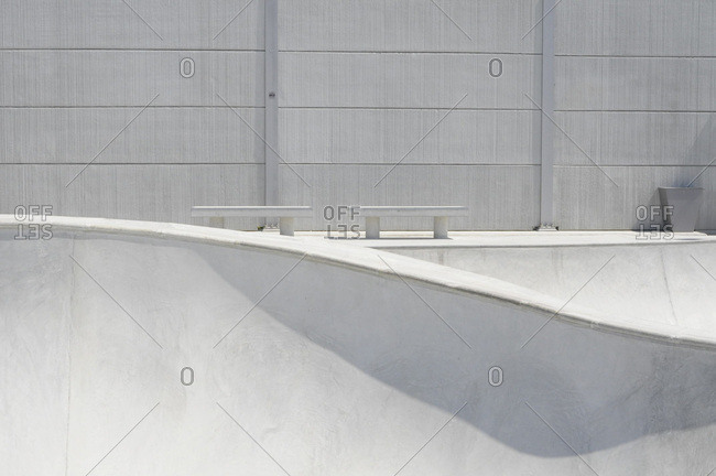 Modern minimalist concrete bowl in skatepark