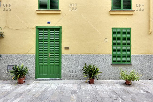 Spain, Majorca, alcudia, house, number 7, facade, door, window, shutters closed, potted plants, pedestrian area