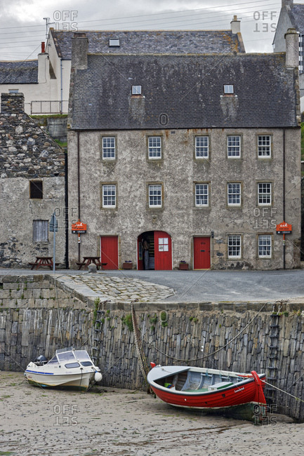 June 19, 2015: Great britain, scotland, aberdeenshire, banffshire, portsoy, harbor, fall dry, boats, house,