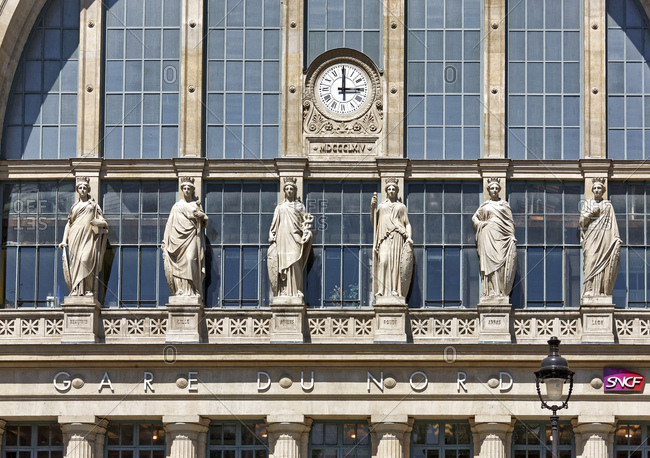 June 8, 2015: France, Paris, station building, facade, statues, clock, 15 o'clock,
