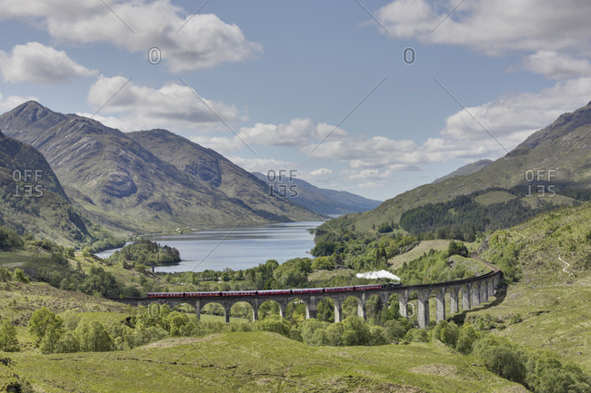 England, scotland, highlands, glenvinnan, train crossing bridge, steam locomotive, lake, mountains, scattered clouds
