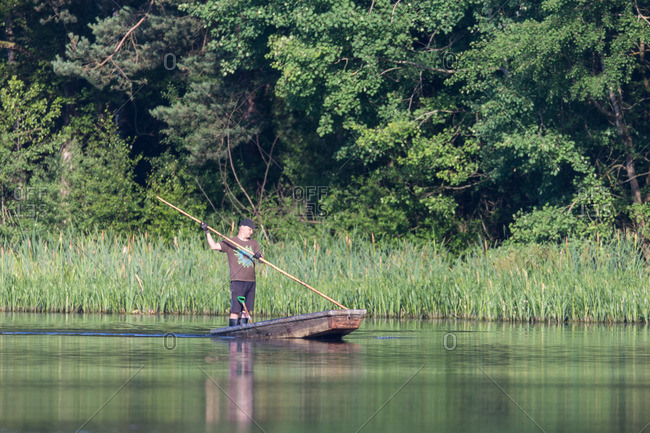 September 7, 2013: Fisherman in a hooker on a lake