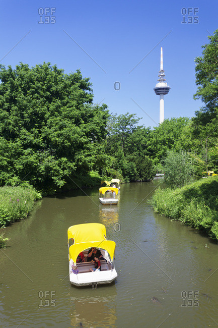 July 8, 2013: Boat excursion on the kutzenweiher, luisenpark, television tower, mannheim, baden-wurttemberg, Germany