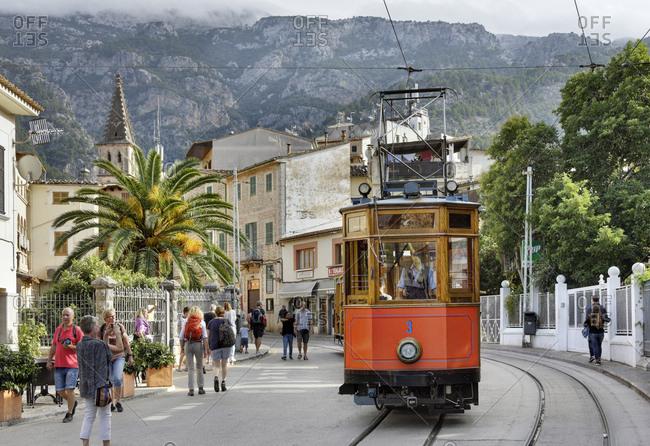 October 9, 2016: Spain, Majorca, soller, streetcar, houses, palm, people