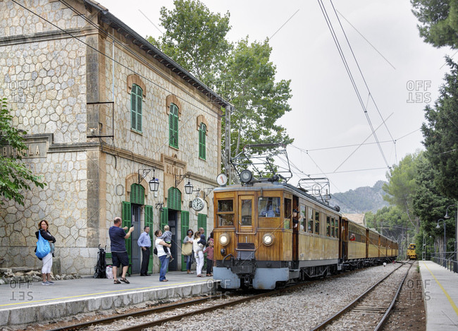 October 9, 2016: Spain, Majorca, bunyola, train, teak, vintage, railway station, platform, people