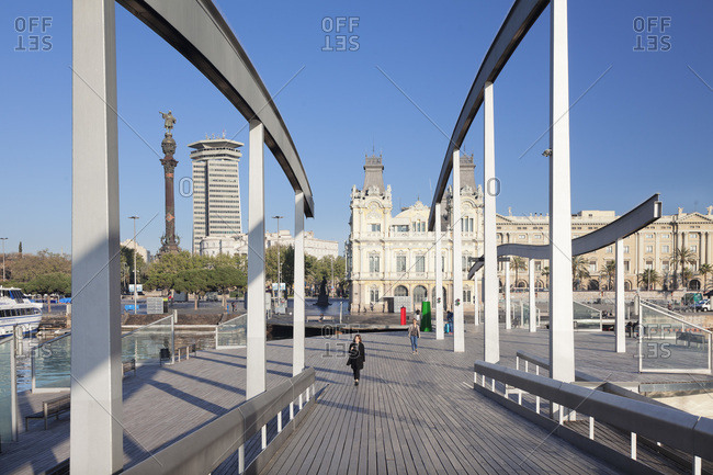 April 9, 2017: Port vell with rambla del mar, high rise edificio colon and columbus column, monument a colom, barcelona, catalonia, spain