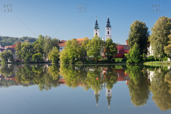 Town lake and abbey church saint peter, bad waldsee, upper swabia, baden-wuerttemberg, Germany