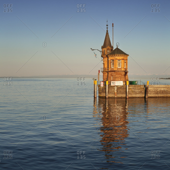 Port entrance of constance with view to the swiss alps at sundown, lake constance, baden-wuerttemberg, Germany
