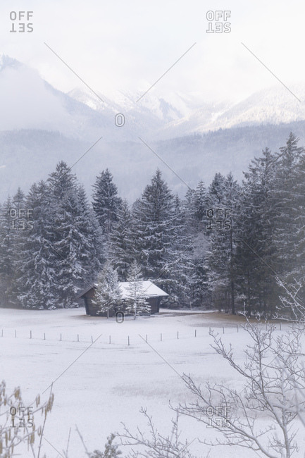 Snowbound hut in the atmospheric landscape of the bavarian alps,