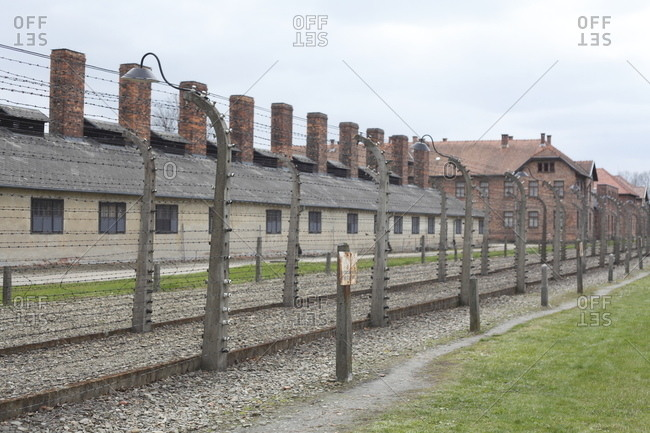 April 20, 2017: Electric barbed wire fence with barracks, death camp auschwitz i, auschwitz, lesser poland, poland, europe