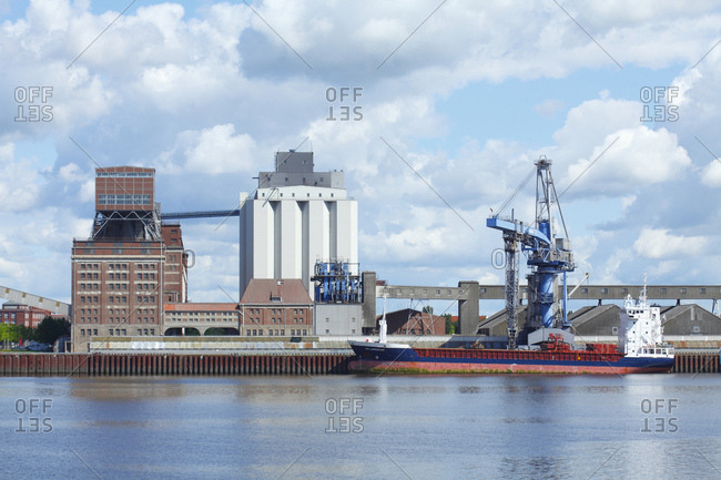 June 28, 2016: Grain harbor, silos, ship, bremen, Germany