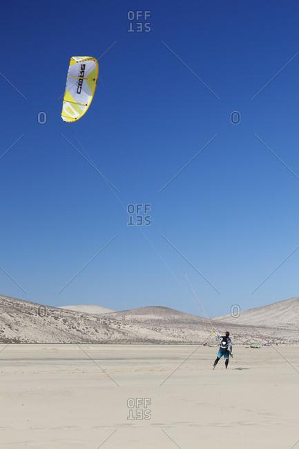 January 5, 2012: Kitesurfer on the beach, risco del paso, fuerteventura, canary islands, spain