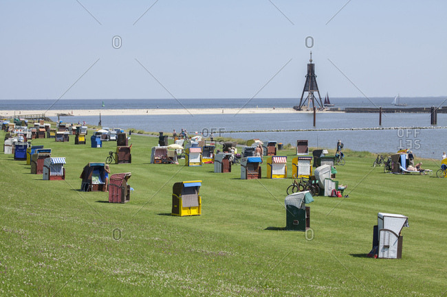 July 11, 2014: Ball buoy, green beach with beach chairs, mudflats in cuxhaven-dose, north sea spa cuxhaven, lower saxony, Germany, europe