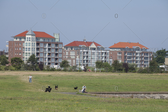 July 11, 2014: Dyke with dwelling houses in cuxhaven-grimmershorn, north sea spa cuxhaven, lower saxony, Germany, europe