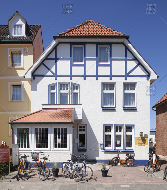 July 11, 2014: Wehrbergsweg, house with bicycle for rent in cuxhaven-duhnen, north sea spa cuxhaven, lower saxony, Germany, europe
