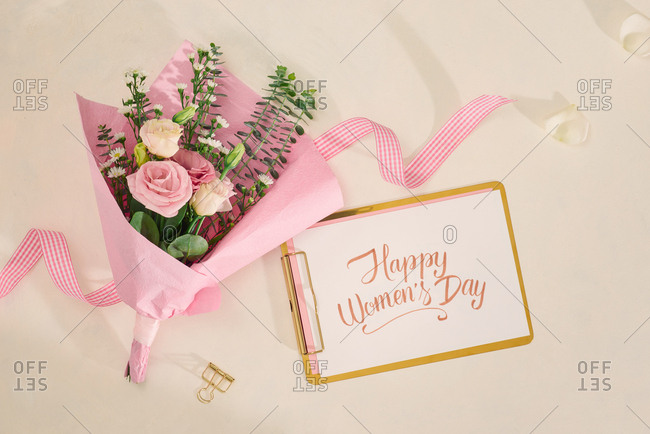Happy valentines day with flower bouquet on white background. Top view, flatlay