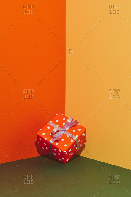 Colorful gift boxes with ribbons on color tabletop