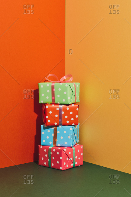 Birthday gift boxes with ribbons on color tabletop