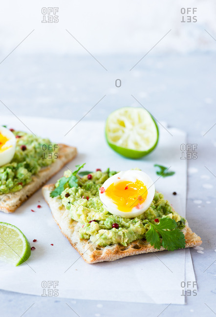Avocado toast with soft-boiled eggs and lime