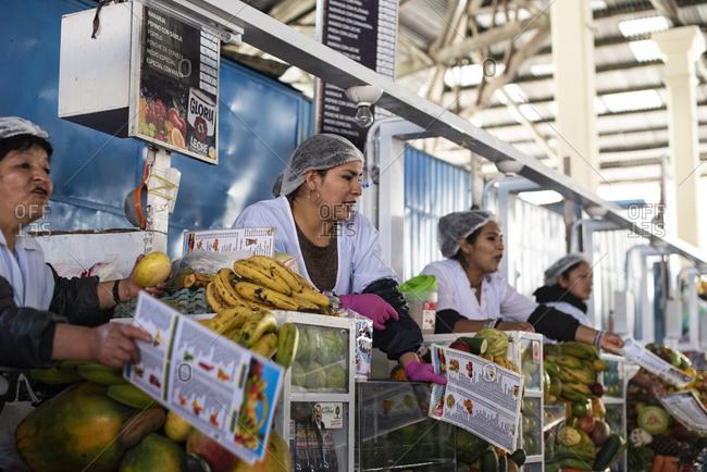 Cusco, Peru - April 4, 2019: Fruit vendors in San Pedro Market