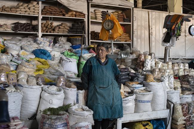 Cusco, Peru - April 4, 2019: Elderly woman vendor in San Pedro Market