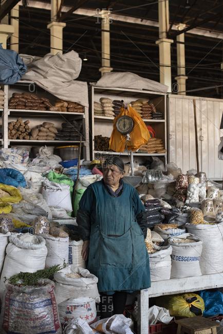 Cusco, Peru - April 4, 2019: Senior woman vendor in San Pedro Market