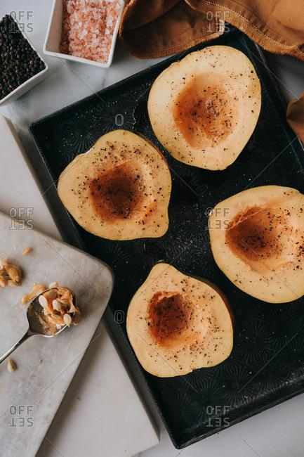 Acorn squash on dark tray