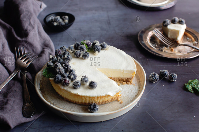 Cheesecake topped with frozen blueberries