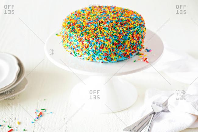 Colorful cake covered in sprinkles