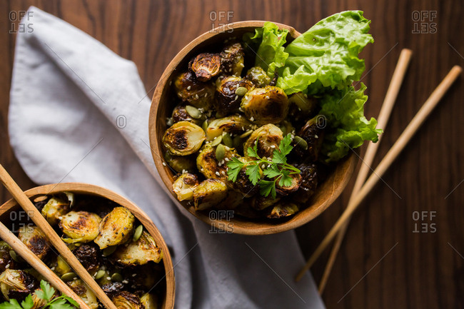Close up of bowls filled with Brussels sprouts with chopsticks