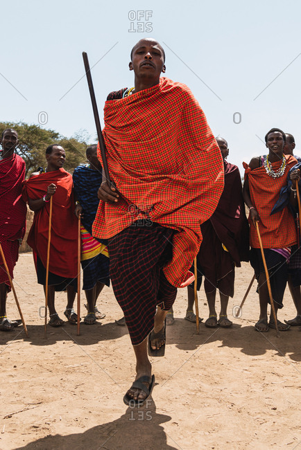 May 28, 2019: African Masai men jumping doing traditional dance in the middle of the savannah in Tanzania