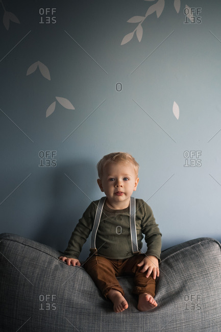 Portrait of a blonde toddler wearing suspenders
