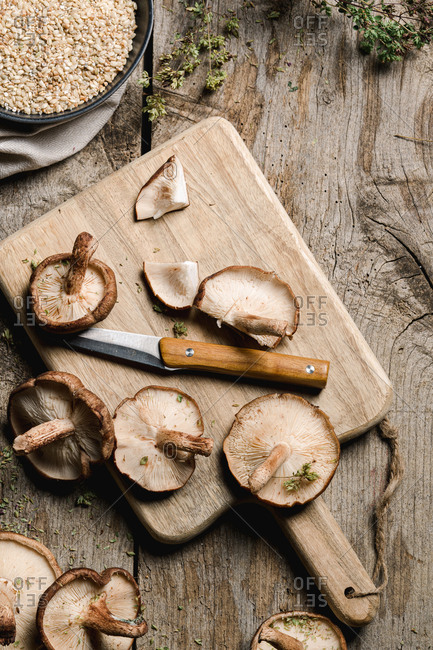 Pile of fresh brown mushrooms on rustic wooden table