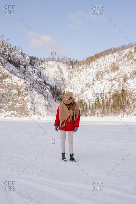 Frozen woman wrapped in scarf on winter day
