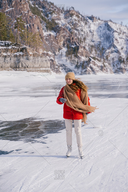 Woman skating on frozen river