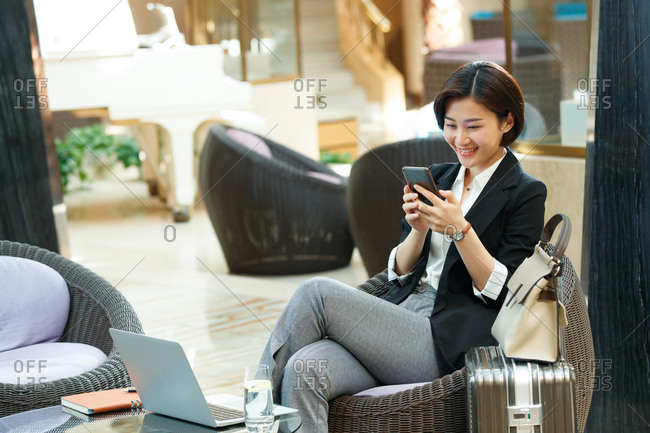 Business lady look at mobile phone